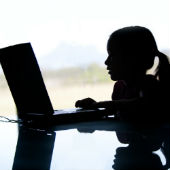 Image of girl at laptop courtesy of Shutterstock