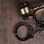 Iamge of gavel and handcuffs courtesy of Shutterstock