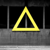 Image of warning triangle courtesy of Shutterstock