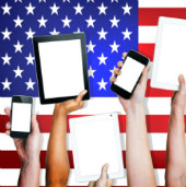 American's holding their tablets and phones, courtesy of Shutterstock