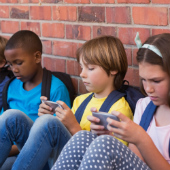 Children with mobile phones, image courtesy of Shutterstock