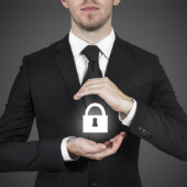 Man with lock, image courtesy of Shutterstock