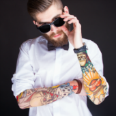 Image of tattooed hipster courtesy of Shutterstock
